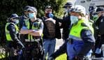 Police detain an anti-mask protester in Melbourne on July 31, 2020. - As greater Melbourne passed the halfway point of a lockdown initially intended to last six weeks, the state of Victoria - of which Melbourne is the capital - recorded over 600 new cases, leaving Premier Daniel Andrews to flag harsher restrictions in a bid to cut the infection rate. (Photo by William WEST / AFP)
