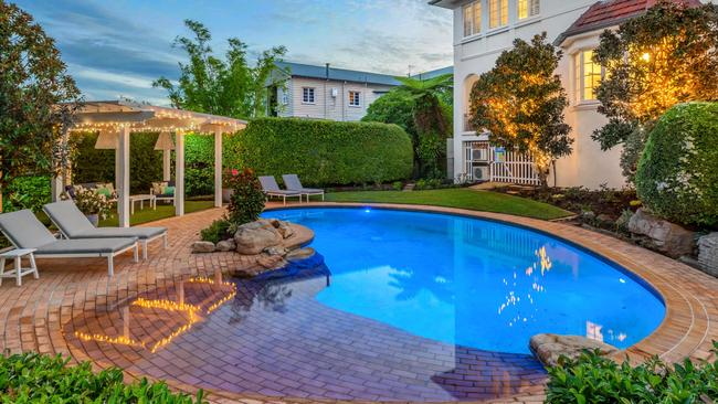 The property is landscaped, with a gazebo and a pool.