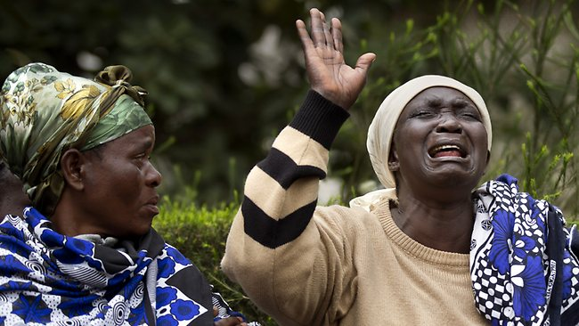 Mary Italo grieves with relatives for her son Thomas Abayo Italo as they wait to receive his body at the mortuary in Nairobi, Kenya.