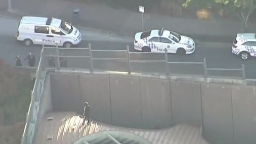 Police are reportedly negotiating with a man armed with a knife at the entrance to the Clem 7 tunnel at Kangaroo Point. Picture: Channel 9
