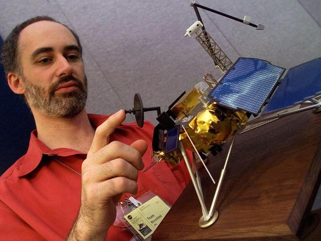 Tom Rivellini, Chief Mechanical Engineer of NASA Deep Space 2 examines a model of the Mars lander which carried the doomed probes.