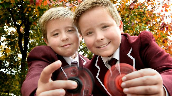 Prince Alfred College students Ryan Tait and Christian Smith with their fidget spinners. Picture: Roy VanDerVegt