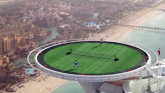 Roger Federer & Andre Agassi have friendly hit on world's most unique court in Dubai.
