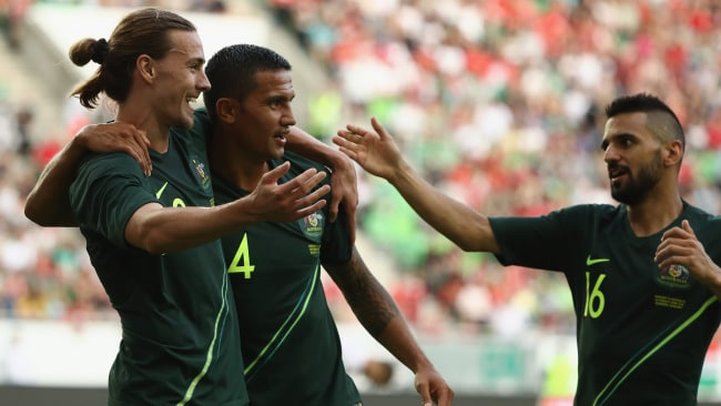 BUDAPEST, HUNGARY - JUNE 09: Jackson Irvine of Australia celebrates with Tim Cahill and Aziz Behich.