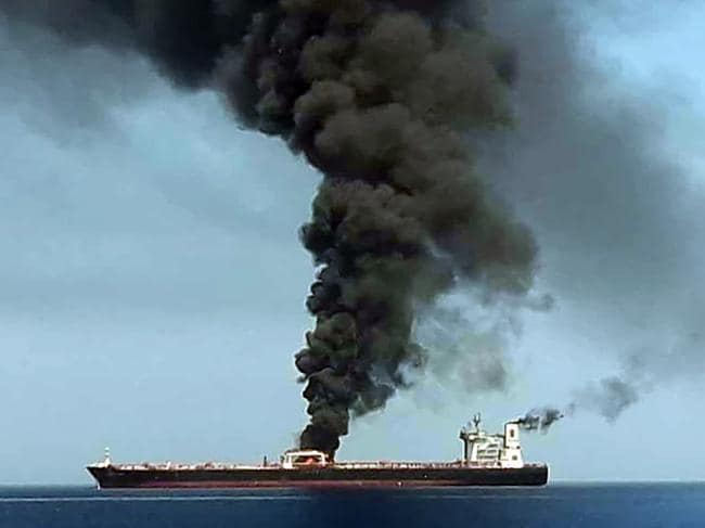 Smoke billows from a tanker said to have been attacked off the coast of Oman. Such attacks have increased tensions between Iran and the US. Picture: AFP