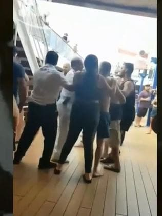 A scuffle on the lido deck.
