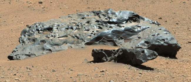 This photo shows a meteorite snapped by Curiosity. The rock, named Lebanon, is an iron meteorite that landed on Mars from somewhere else in space. Picture: NASA