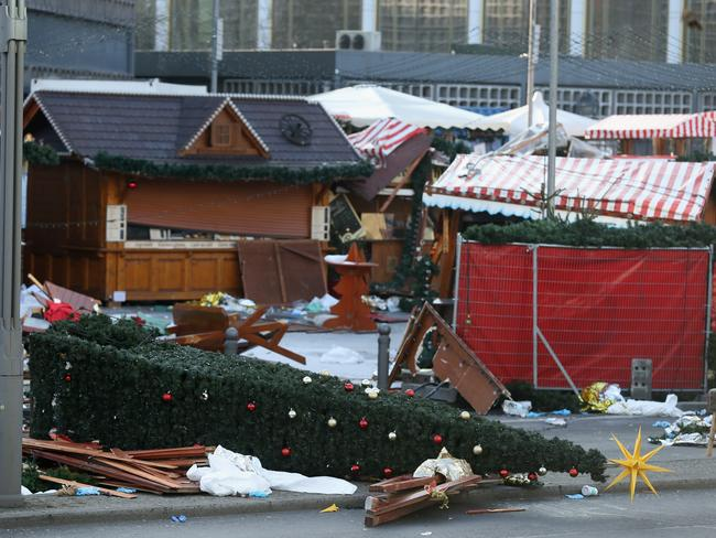 The wrecked remains of the Christmas market stand where two days before a man drove a heavy truck into the market in an apparent terrorist attack in Berlin, Germany. Picture: Getty
