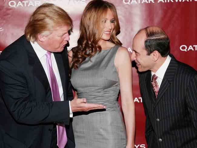 Donald and Melania Trump chat with Qatar Airways CEO Akbar Al Baker at a Qatar Airways gala to celebrate their inaugural flights to New York in 2007. Picture: Evan Agostini/Getty Images