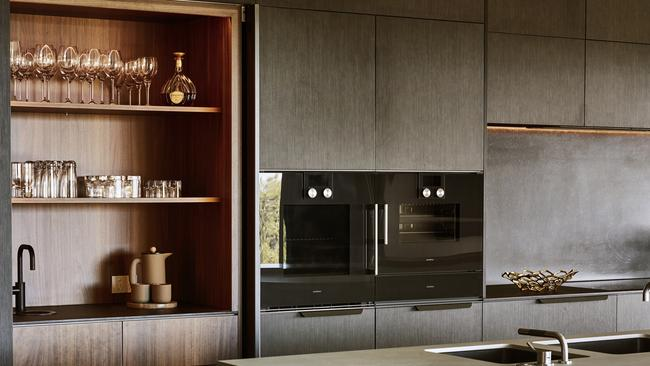 Dark tones and wood play off each other in the Brisbane kitchen. Picture: Supplied.
