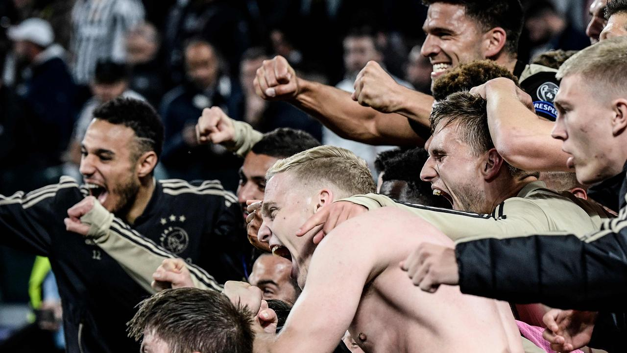 Donny van de Beek is mobbed by his teammates