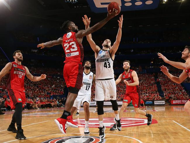 Terrico White of the Wildcats and Chris Goulding of United contest for a rebound. Picture: Paul Kane/Getty Images