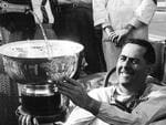 Sir Jack Brabham with trophy after winning the Australian Grand Prix at Sandown in 1964.
