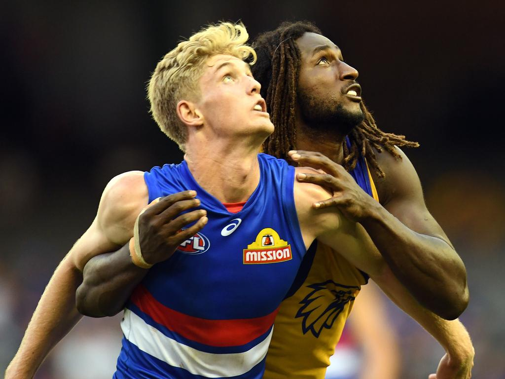 Tim English of the Bulldogs (left) and Nic Natanui of the Eagles contest during the Round 2 AFL match between the Western Bulldogs and the West Coast Eagles at Etihad Stadium in Melbourne, Sunday, April 1, 2018. (AAP Image/Julian Smith) NO ARCHIVING, EDITORIAL USE ONLY