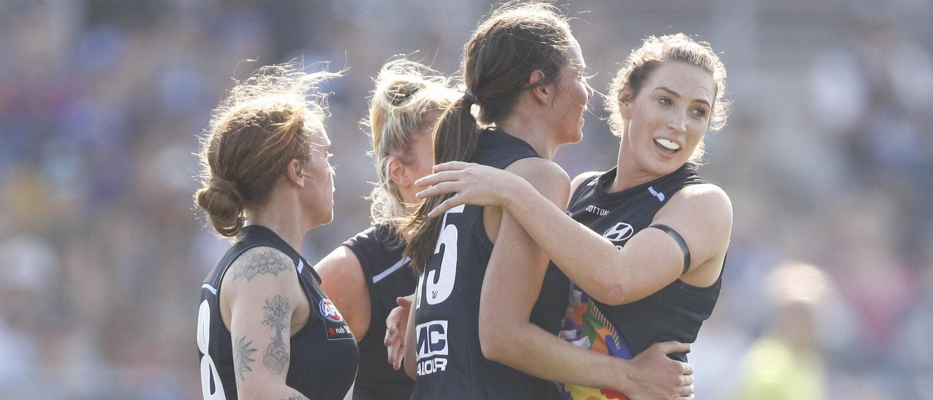 Chloe Dalton of the Blues (second right) celebrates a goal with teammates during the Round 7 match between the Western Bulldogs and the Carlton Blues at Victoria University Whitten Oval in Melbourne, Sunday, March 17, 2019. (AAP Image/Daniel Pockett) NO ARCHIVING, EDITORIAL USE ONLY
