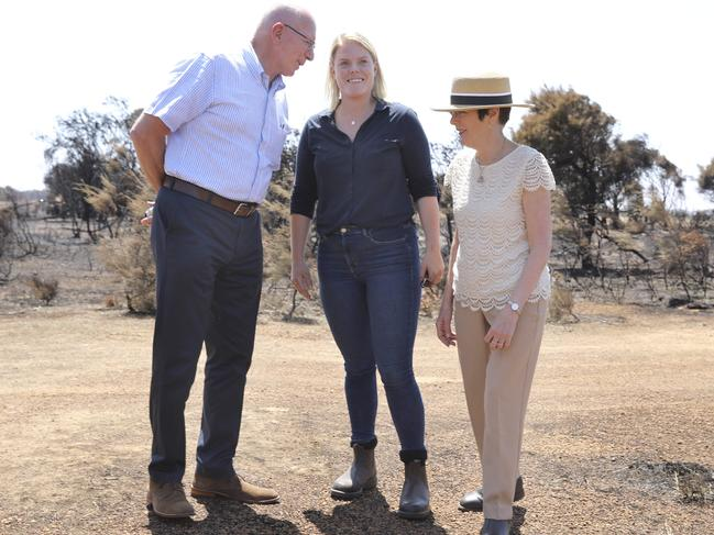 Stephanie Wurst who lost her home, has a rare moment to smile as she chats to Governor-General David Hurley and his wife Linda on Tuesday. Picture: Dean Martin