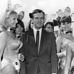 Playboy editor and tycoon Hugh Hefner is greeted by a group of bunny girls from his Playboy Clubs, upon his arrival at London Airport. Picture: Getty