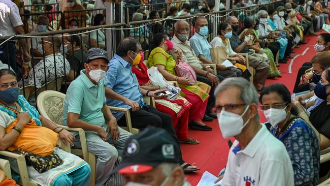 People queue up to receive a dose of a coronavirus vaccine in Mumbai on April 27. Picture: Punit Paranjpe/AFP