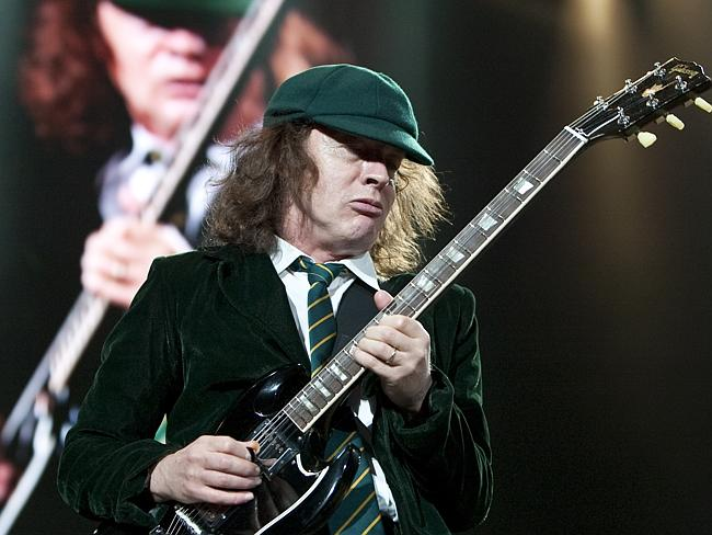 Rock on ... Guitarist Angus Young plays to the crowd during AC/DC's Sydney concert during their Black Ice Australian tour.