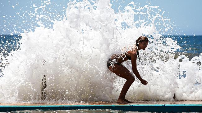 Kiahni Scott, 12, beats the heat in the water at Collaroy. Picture: Adam Yip / Manly Daily