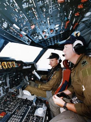 RAAF Orion crew members Squadron Leader Alf Jonas (left) and Flight Sergeant Darren Sambell in the cockpit of the maritime patrol aircraft. Picture: Campbell Brodie