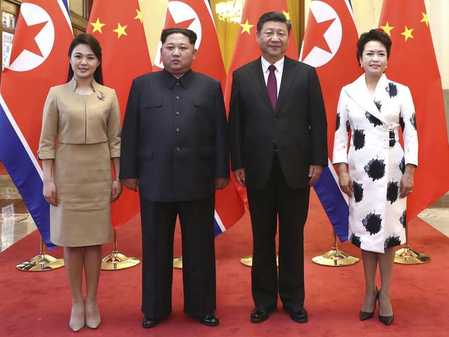 Ri Sol Ju, left, stands next to her husband, Kim Jong-un, and Chinese President Xi Jinping with his wife Peng Liyuan. Picture: Xinhua