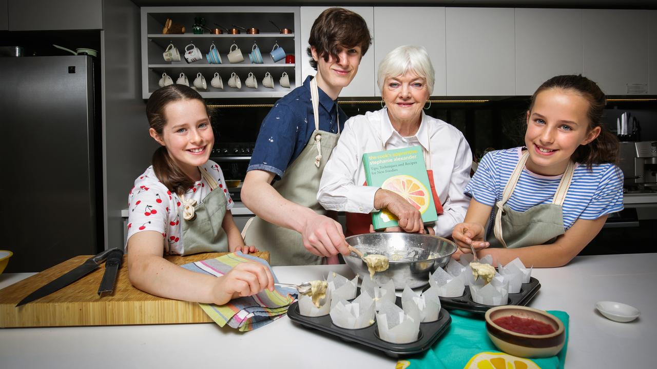 Chef and kids' food educator Stephanie Alexander (holding book) with Lucy, Riley and Clara. Picture: Nicole Cleary