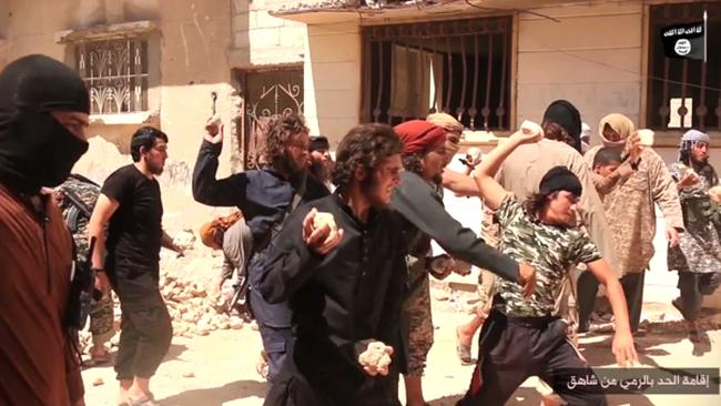 Islamic State militants stone a man accused of violating the extremists' ban on homosexuality after they threw him from a roof in the city of Homs, Syria.