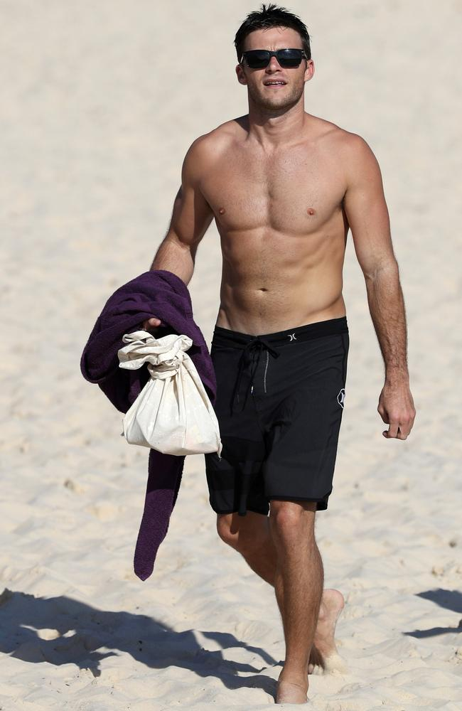 Scott Eastwood pictured going for a swim at Bondi Beach with friend Rhys. Picture: BackGrid