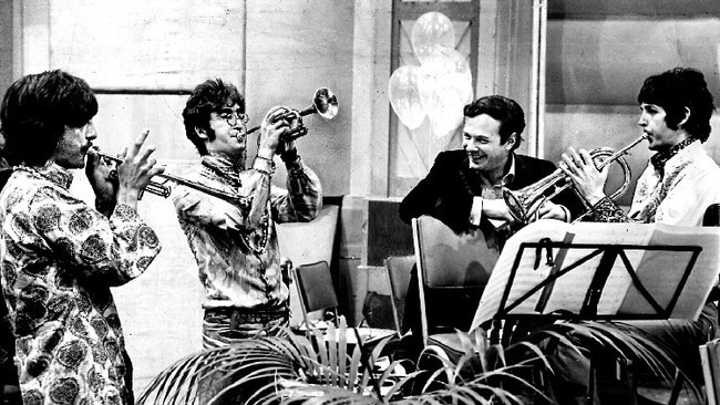 Beatles manager Brian Epstein watches George Harrison, John Lennon and Paul McCartney during a jam session in 1960s.