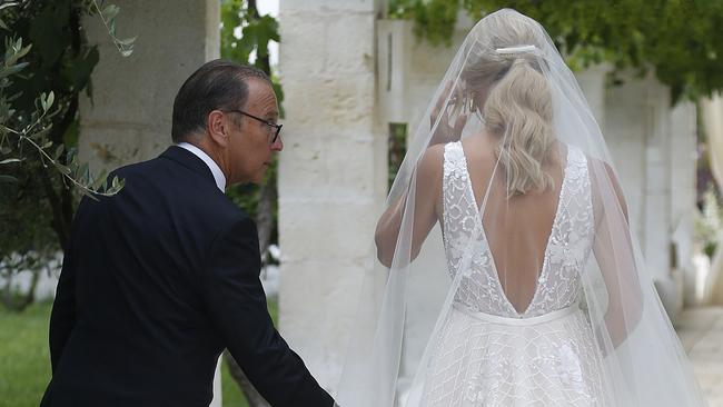 The Bachelor star was walked down the aisle by her father Les Heinrich. Picture: Matrix