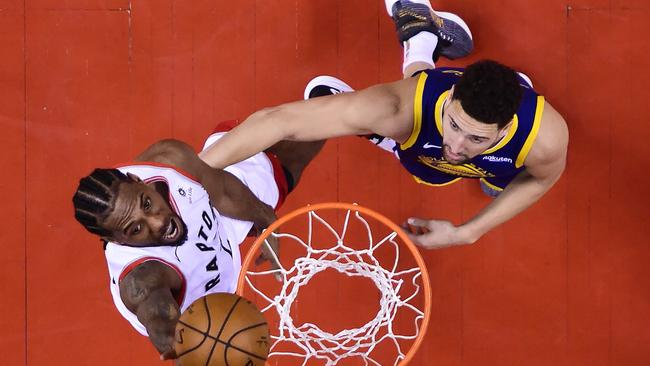 Toronto Raptors forward Kawhi Leonard scores past Golden State Warriors guard Klay Thompson in Game 5 of the NBA Finals. Picture: Nathan Denette/The Canadian Press via AP