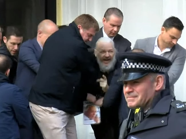 Assange after he was arrested. Picture: Supplied