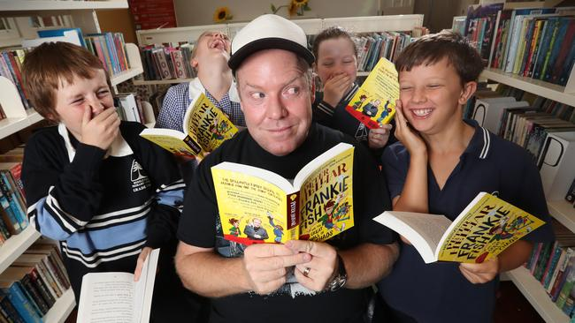 Middle Park Primary School students giving the thumbs up for Helliar's new book. Picture: Alex Coppel.