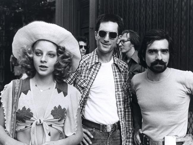 Actors Jodie Foster and Robert De Niro with director Martin Scorsese on the set of Taxi Driver.