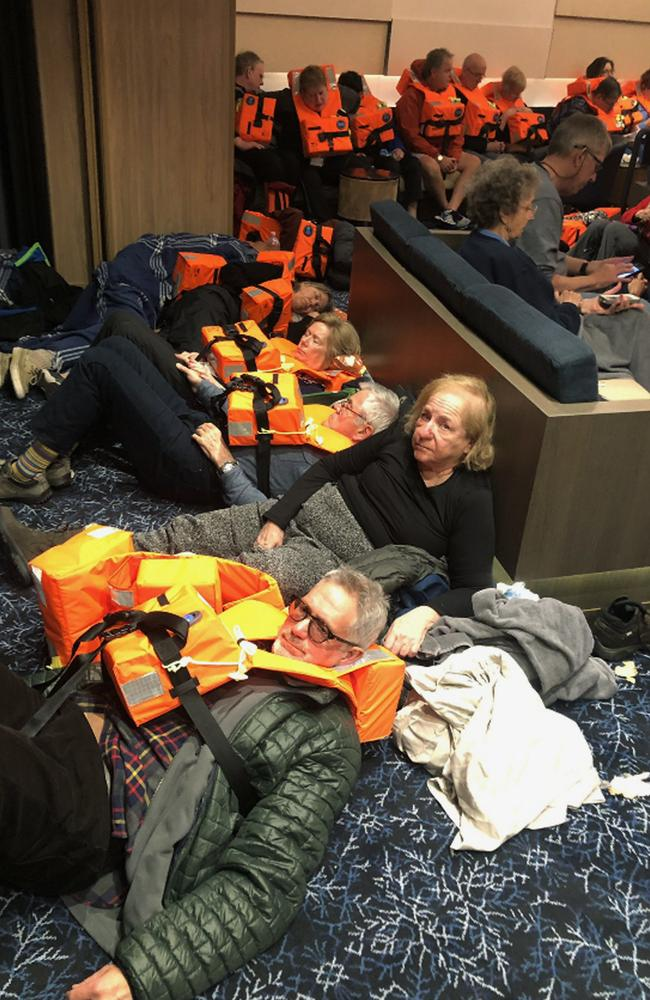 Tired and frightened passengers on board the Viking Sky waiting to be evacuated off the coast of Norway. Picture: Alexus Sheppard via AP
