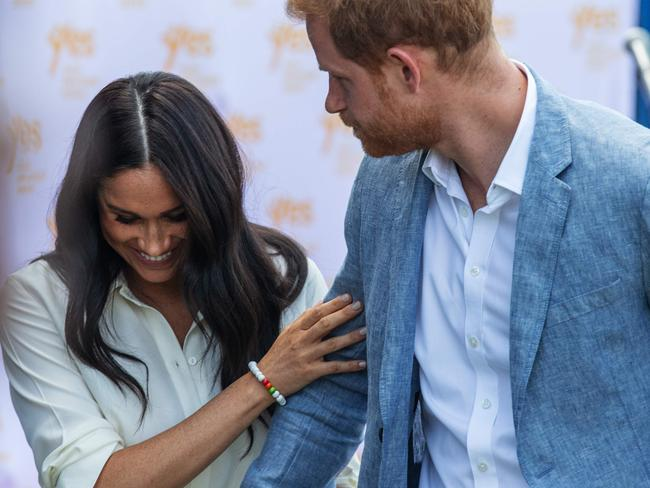 Harry was particularly protective of Meghan during a visit to the Youth Employment Services Hub in Tembisa township, Johannesburg. Picture: Michele Spatari/AFP