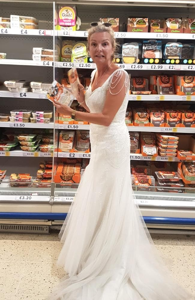 From food shopping to cleaning, cooking and paddle boarding, Dawn has certainly made the most out of her gown. Picture: Caters News.