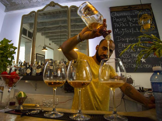 Private bars are flourishing in the wake of increased interest in travel to Cuba. Picture: AP Photo/Desmond Boylan