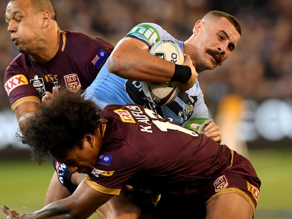 Reagan Campbell-Gillard of the Blues is tackled by Felise Kaufusi and William Chambers of the Maroons during Game 1 of the 2018 State of Origin series at the MCG in Melbourne, Wednesday, June 6, 2018. (AAP Image/Joe Castro) NO ARCHIVING, EDITORIAL USE ONLY