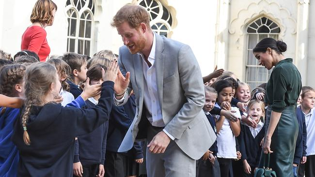Prince Harry, Duke of Sussex and Meghan, Duchess of Sussex greet local school children in Brighton. Picture: Tabatha Fireman/Getty Images