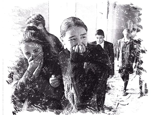 Time of terror ... Girls cry as they walk through the rubble of Beslan's school No. 1 shortly after the attack. Original image: AP