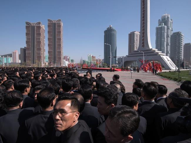 Attendees wait for the arrival of North Korean leader Kim Jong-un ahead of the opening ceremony for the Ryomyong Street housing development in Pyongyang. Picture: Ed Jones/AFP