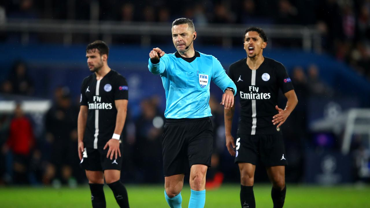 Referee, Damir Skovina awards a penalty to Manchester United