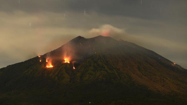 Trees burn on the slopes of Mount Agung after it erupted on July 3, 2018. Sonny Tumbelaka