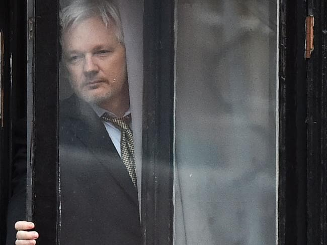 WikiLeaks founder Julian Assange coming out onto the balcony of the Ecuadorean embassy to address the media February last year. Picture: AFP/Ben Stansall
