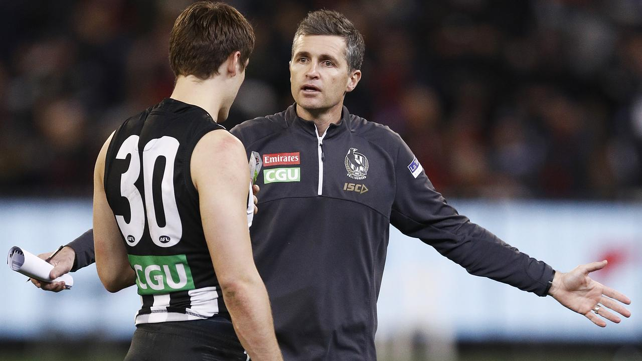 MELBOURNE, AUSTRALIA — AUGUST 23: Magpies assistant coach Justin Longmuir (R) speaks with Darcy Moore of the Magpies during the round 23 AFL match between the Collingwood Magpies and the Essendon Bombers at Melbourne Cricket Ground on August 23, 2019 in Melbourne, Australia. (Photo by Daniel Pockett/Getty Images)