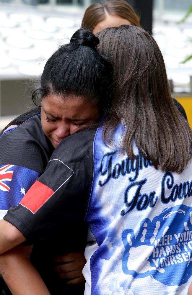 """""""Tragic case"""": The family of one-punch victim Trevor Duroux embrace outside the Supreme Court in Brisbane after Heather was sentenced to six and a half years jail over deadly attack. Picture: AAP/Dan Peled"""