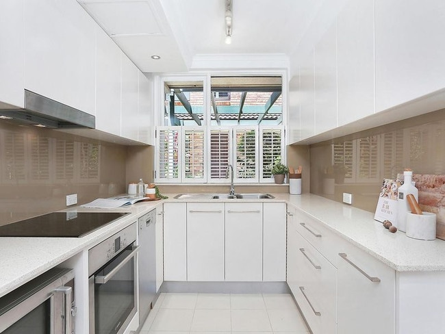 The kitchen is electric and has plenty of storage.