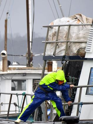 A man battles wild weather at Mornington Pier. Picture: Adam Richmond